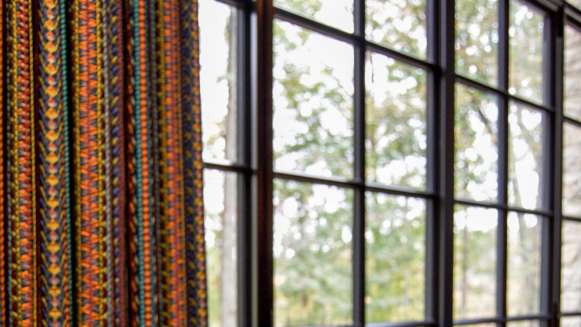 Steel glazed windows with curtains