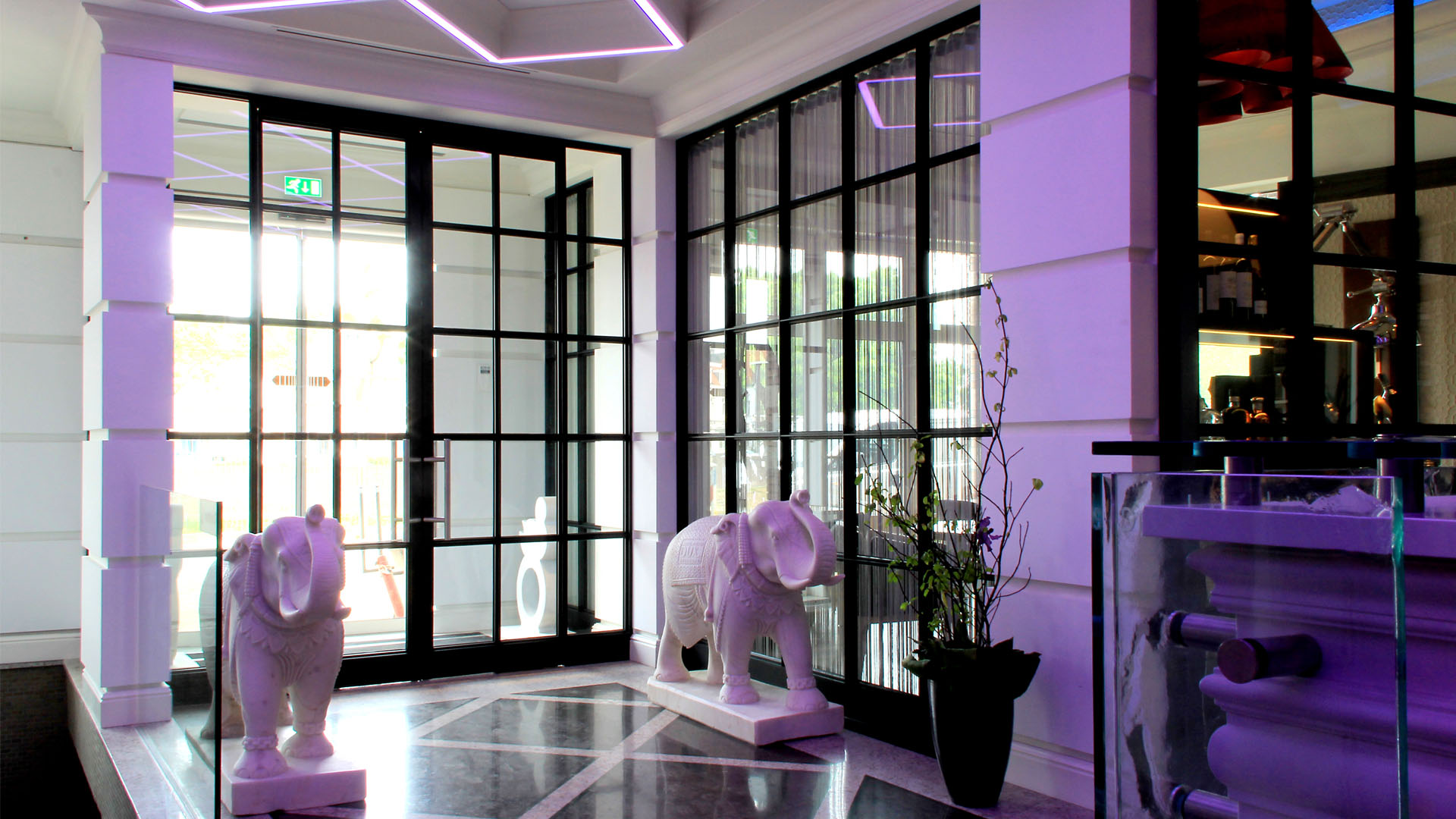 MHB indoor partitions in purple lit Hotel Dux, Roermond, The Netherlands
