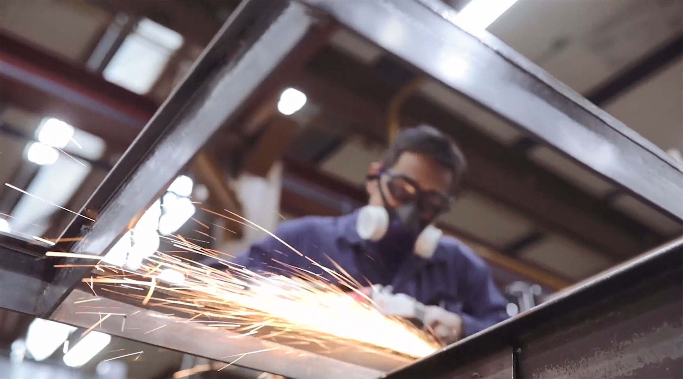 MHB craftsman welding an SL30-ISO profile system
